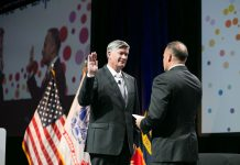 Col. Marv Fisher, F.SAME, USAF (Ret.), sworn in as 99th SAME President at the 2018 JETC in Kansas City.
