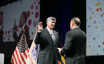 Col. Marv Fisher, F.SAME, USAF (Ret.), sworn in as 99th SAME President at the 2018 JETC in Kansas City.
