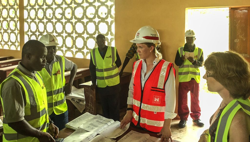 A project team lead by USACE Europe District reviews plans for a secondary school being constructed in Toffo, Benin, in West Africa.